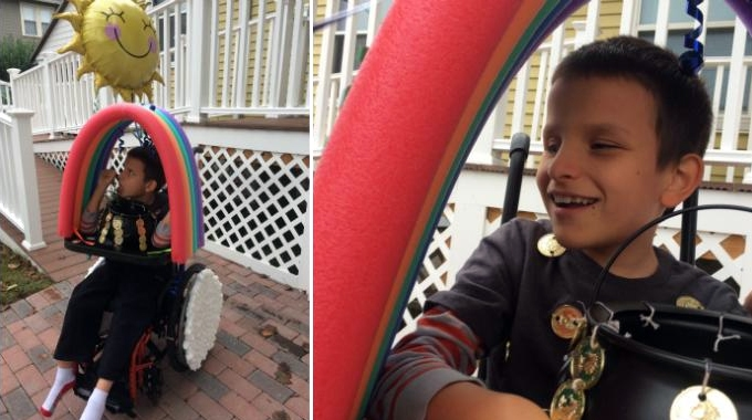 A boy dressed up for Halloween as a pot of gold at the end of a rainbow