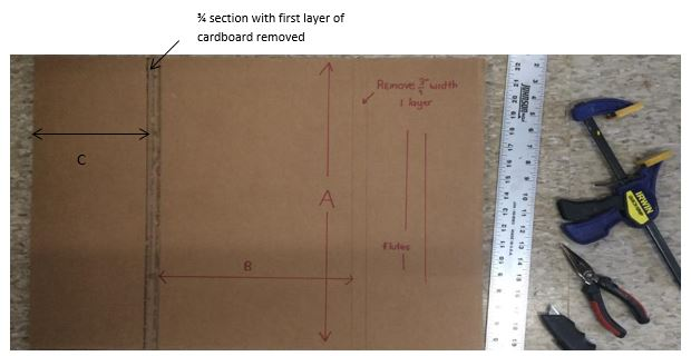 cardboard with marks measured and showing a 3/4 section of removed cardboard