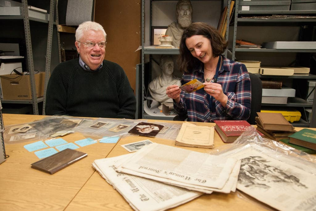 Prof. James Trent and Molly Stothert-Maurer (Archivist) peruse the collection and share a chuckle over a postcard from the Wenham Museum showing a miniature Julia Ward Howe doll. Photo credit: Anna Miller.