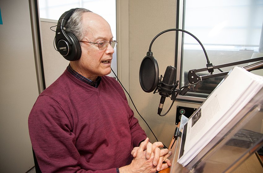 Volunteer narrator Bart Morse in the recording studio where he recorded the 1,000th digital audio book for the Perkins Library. Photo Credit: Anna Miller.