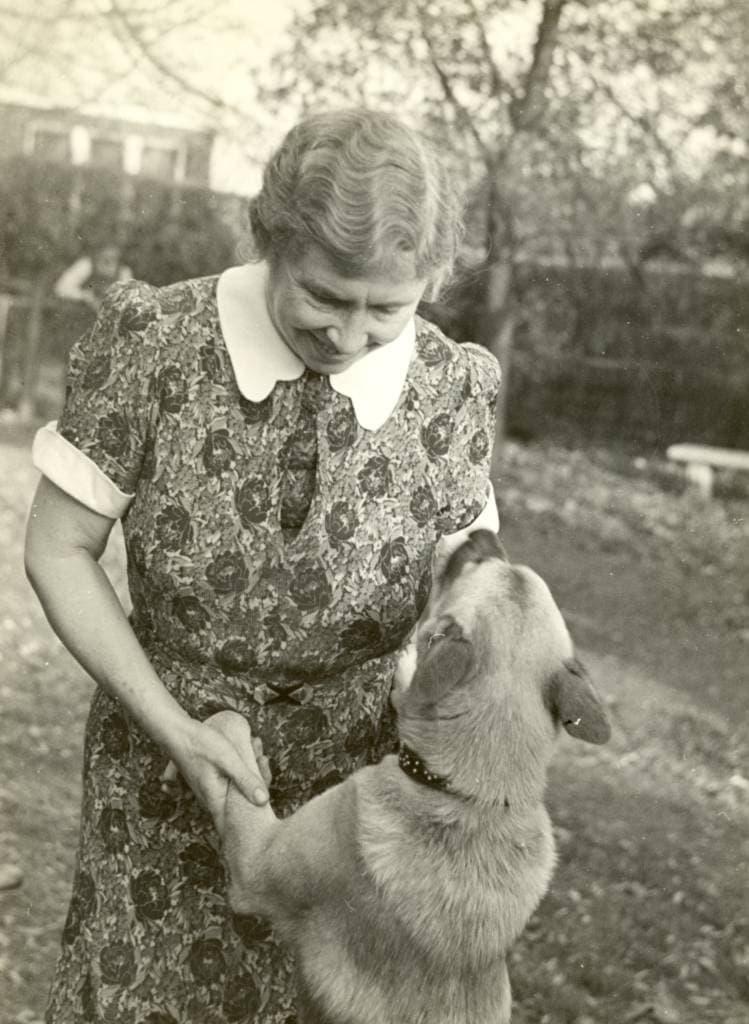 Helen Keller with her dog outside