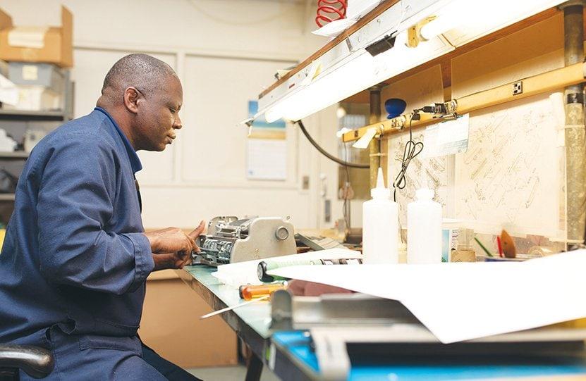 Enock works in the brailler repair shop.