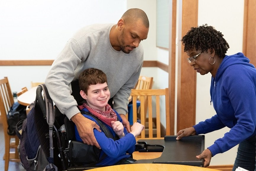 Kaique Manuel of São Paulo, Brazil, pictured here behind a student in a wheelchair, is one of three 2020 ELP participants from Latin America.