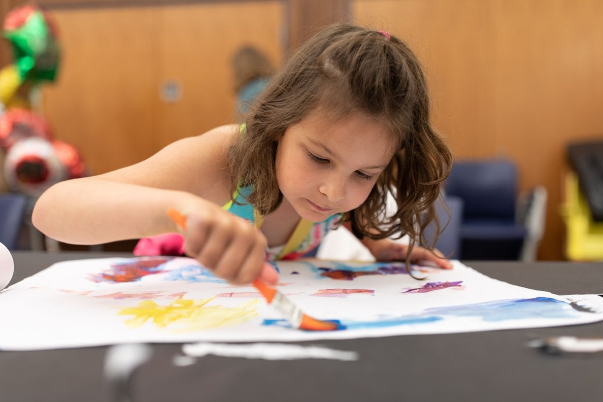 A young girl painting