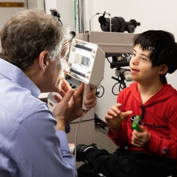 A young boy receiving an evaluation for low vision.
