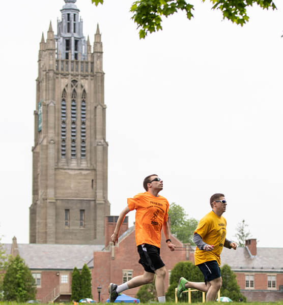 Two men running outside together near the Perkins campus