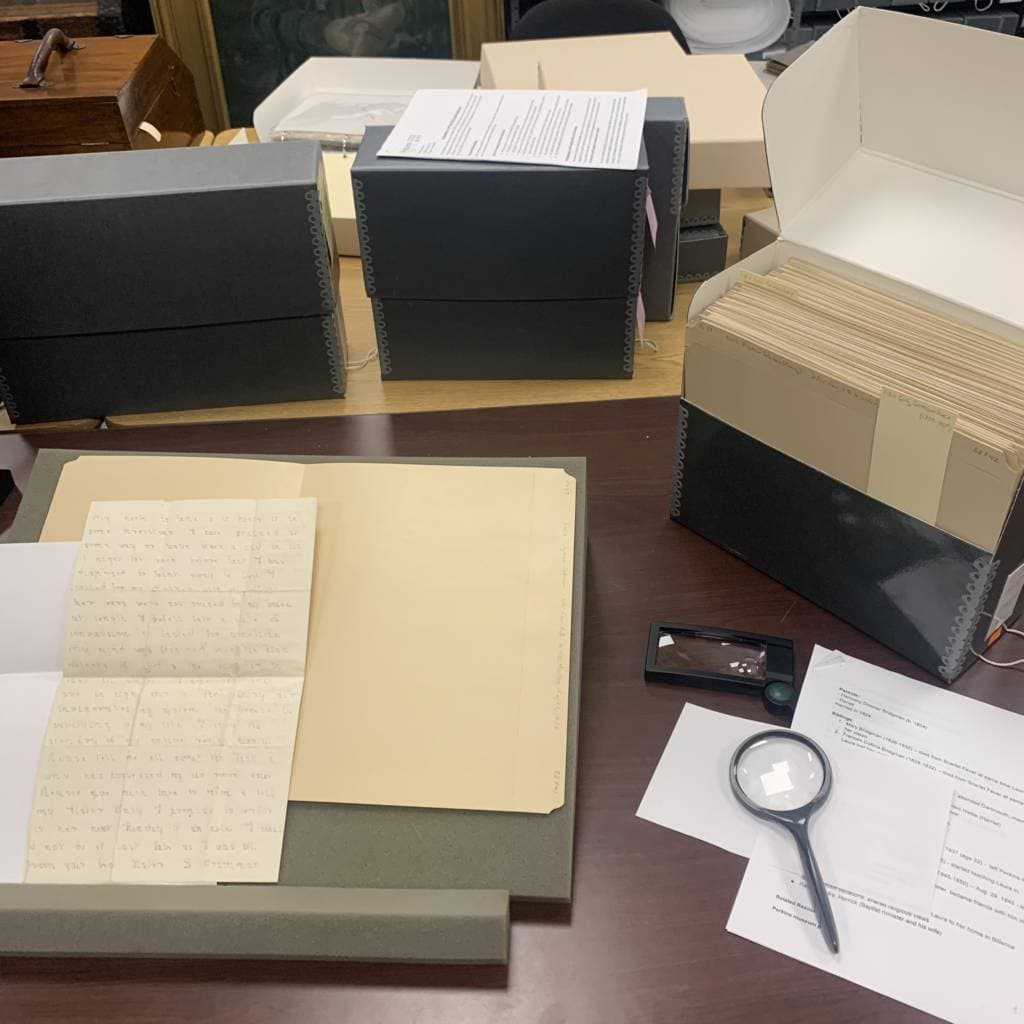 Archival research scene with historical document