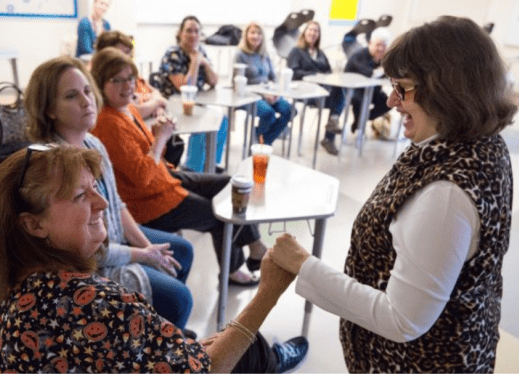 Jaimi Lard signs with a Grafton school system nurse during presentation