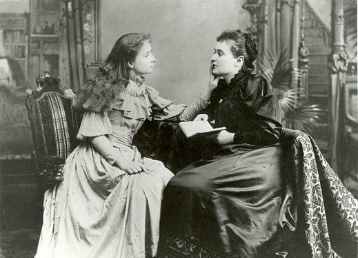 Helen Keller and Anne Sullivan sitting together.