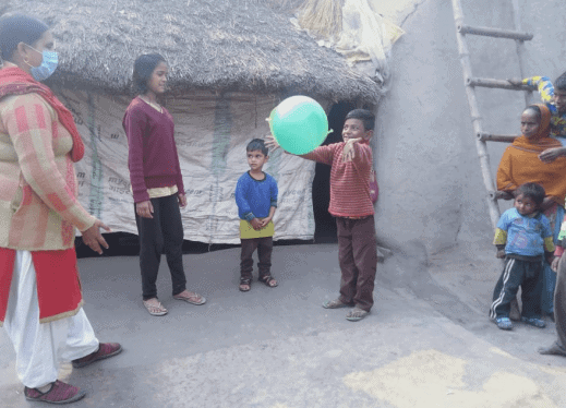 Ishan enjoys playing with the ball with his siblings and his teacher, Sofia