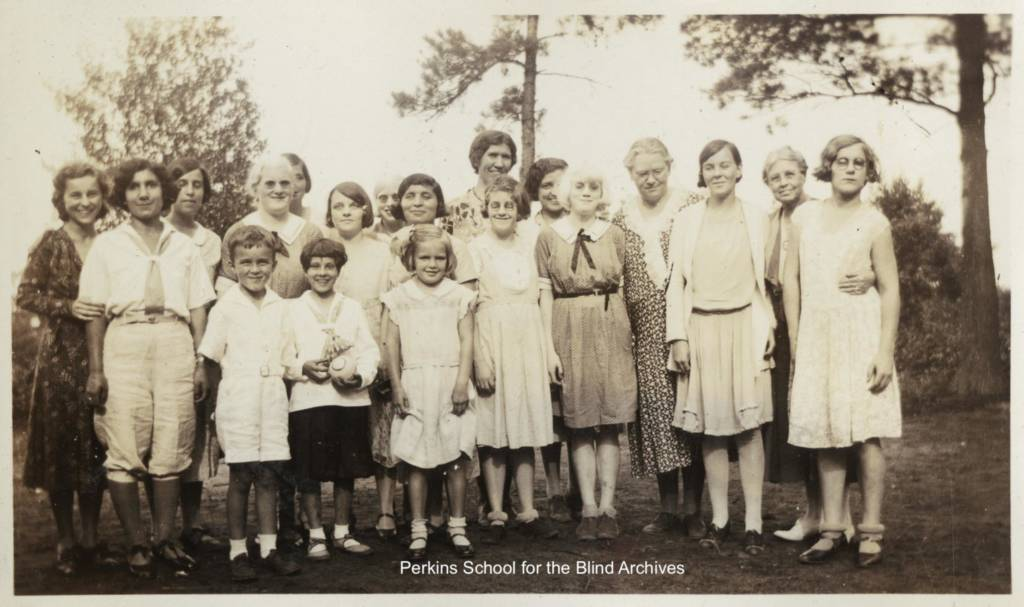 Group portrait of campers and some of the staff, circa 1932.
